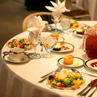 A picture of salad plates on a formally set table